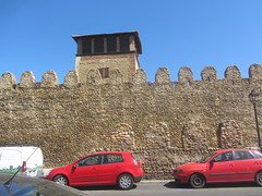 Detail of  tower and the Medieval citywalls (or cerca),  Leon. (d.kevan) Tags: citywalls avenidadeindependencia walls battlements streelamps cars street pavement xiithcentury buildings tower leon immaculateconception convent doublewall