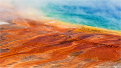 The Colors of Yellowstone (Sandra Lipproß) Tags: grandprismaticspring midwaygeyserbasin yellowstone nationalpark wyoming rockymountains usa travel nature vulcanism hotspring microbialmats colors colorful blue green red orange bacteria archaea steam outdoor colours colourful