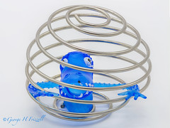 Get me out of Here! (toonarmy59) Tags: macromondays wire wirecage highkey fingerpuppet toy desktopphotography blue white silver