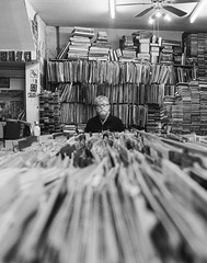 Snu-Peas Record Centre, Boscombe (Attila Pasek (Albums!)) Tags: portrait bronicasqa mediumformat shop bw profession film analogue hp5 snupeas man boscombe business camera blackandwhite music record ilford bakelite 120film