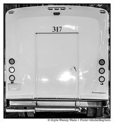 The Big, White Backside of Vehicle 317 (Doyle Wesley Walls) Tags: door white object tires number bumper font vehicle 317 lagniappe 5585 doylewesleywalls handle