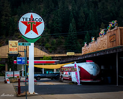 Gas, Donuts, and Bikes (See what I see.) Tags: smalltown texaco signage usa idaho bus bicycles neon wallace dinner gasstation