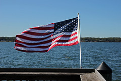 on the dock (scott1346) Tags: flag red white blue water river patuxentriver windy patriot american 1001nightsthenew symbol oldglory starsandstripes 1001nightsmagiccity solomonsis canont3i autofocus contactgroups