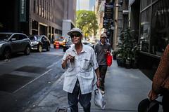Tea (Nun Nicer Artist) Tags: tea manhattan streetphotography travel people newyork nunnicer 35mmstreetphotography 35mm walking drink street