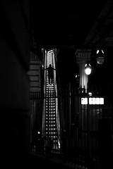 Cross-shaped (pascalcolin1) Tags: paris13 homme man métro subway lumière light escalier stairs croix crossshaped nuit night photoderue streetview urbanarte noiretblanc blackandwhite photopascalcolin 50mm canon canon50mm