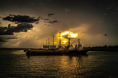 Sunset And Rain (Markus Branse) Tags: from sunset waterfront hill darwin wharf stokes northern seen territory austrlaia cloud rot weather clouds sonnenuntergang wolke australia australien wetter meteo woken weer abendrot abendstimmung sonnenuntegang ocean red sea orange water see meer wasser ship ships vessel hafen rood schiff schiffe landscape evening pier landschaft habour