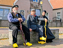 Take me Back to the Old Days (Hindrik S) Tags: people posing three trio streetphoto strjitfotografy strasenfotografie straatfotografie elburg klomp klompen woodenshoes stick cane kierie stok stôk spazierstock stock old elder ouderen âlderein sitting sitte zitten sitzen history skiednis historie sonyphotographing sony sonyalpha amount minoltaamount on1photoraw2019 on1pics a77ii α77 slta77ii sonya77ii sonyilca77m2 sony1650mmf28dtssm 2019