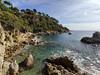 LLoret de Mar (piotr_szymanek) Tags: lloret costabrava lloretdemar outdoor water sea landscape shore beach stone wall green blue sky tree 1k 5k