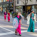 Columbus Day Parade in Chicago: women in traditional pink and turquoise costumes from East Asia, with parasol and musical instrument