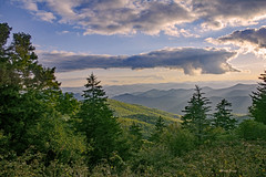 Clouds And Evergreens (mevans4272) Tags: mountains trees evergreens sun nc parkway ridge blue outdoors
