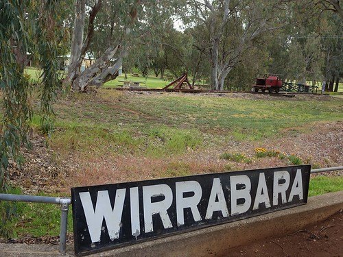 Wirrabara. The old SAR South Australian Railways station sign. The railway reached here in 1910. Beyond a railway ganger's maintenance car.