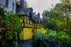 Yellow House Dean Village (Brian Travelling) Tags: scotland pentax pentaxk20d peaceful architecture bluesky coloursofscotland castle edinburgh east green historic interesting landscape cityscape sunset sunsetsandsilhouettes silhouette outdoor peace squirrel river scenic scenery scottish trees tranquil tree tranquility urban vibrant varied waterofleith dean village deanvillage