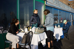 Volna (dtanist) Tags: nyc newyork newyorkcity new york city sony a7 7artisans 35mm brooklyn brighton beach volna restaurant outdoor dining seating table boardwalk customers patron patrons