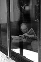 Reading At Schilling's Barcelona (Bury Gardener) Tags: catalonia spain europe 2019 streetphotography street streetcandids snaps strangers candid candids people peoplewatching folks fujixt3 fuji fujifilm bw blackandwhite monochrome mono
