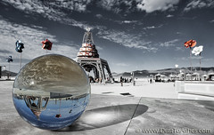 Burning Man in Sphere (Dust To Ashes) Tags: burningmanfestival burningman2019 burningman metamorphoses theme burning man bm2019 2019 dust ashes dusttoashes wwwdusttoashesnet sculpture sculptures installation installations surreal playa desert nevada gerlach nv blackrockcity brc art burningmanart desertparty photography photos photo pictures ales glass sphere crystal ball upside down couryard