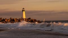 Walton Lighthouse (M@ H) Tags: landscapes ocean sea nature lighthouse water sunset orange yellow waves boat sailboat sail explorer