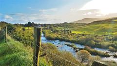 Irish Countryside (jimboyrer) Tags: country ireland stream grassland field cows mountains clouds