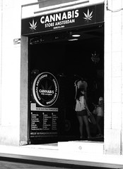 At the Cannabis Store (Bury Gardener) Tags: catalonia spain europe 2019 streetphotography street streetcandids snaps strangers candid candids people peoplewatching folks fujixt3 fuji fujifilm bw blackandwhite monochrome mono