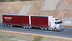 Reds (2 of 3) (Jungle Jack Movements (ferroequinologist) all righ) Tags: booths scania kenworth k200 glasson transport heywoods ks freighters conroys gap nsw new south wales australia australian hume highway burley griffin way hp horsepower big rig freight cabover trucker drive carry delivery bulk lorry hgv wagon road nose semi trailer deliver cargo interstate articulated vehicle load freighter ship move motor engine power teamster truck tractor prime mover diesel injected driver cab cabin loud wheel double b goondah red