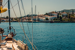 Landfall...... (Dafydd Penguin) Tags: spetses island saronic gulf aegean mediterranean greece sea water yacht yachting sail sailboat sailing cruise cruising boat town coastal village anchorage leica m10 voigtlander 21mm f35 color skopar vintage line