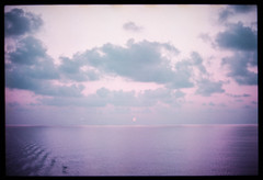 italian seascape (Lomochrome Purple) (mmartinsson) Tags: nikkor50mmf14 lomography mediterranian ocean sunset clouds 35mm nikonf3 lomochromepurple sky epsonperfectionv700 analoguephotography 2019 film scannegative messina italien