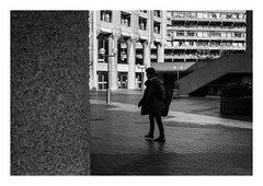 FILM - Passing with a guitar (fishyfish_arcade) Tags: 35mm analogphotography bw barbican blackwhite blackandwhite filmphotography filmisnotdead hp5 istillshootfilm london monochrome olympusom1 zuiko50mmf18 analogcamera film ilford mono streetphotography guitar