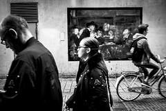 targets (Gerrit-Jan Visser) Tags: geimporteerd streetphotography bnw blackandwhite rembrandt van rijn streetart target people moving warmoesstraat amsterdam fading old painting museum history