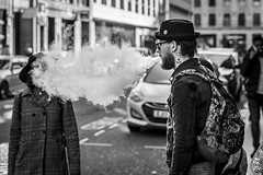 Obscured (Leanne Boulton) Tags: urban street candid portrait streetphotography candidstreetphotography streetlife sociallandscape man male face tattoo hat style fashion smoke smoker smoking ecig electroniccigarette vape vaper vapour vaping subohm cloud tone texture detail depthoffield bokeh naturallight outdoor light shade city scene human life living humanity society culture lifestyle people canon canon5dmkiii 70mm ef2470mmf28liiusm black white blackwhite bw mono blackandwhite monochrome glasgow scotland uk