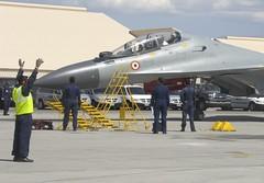Indian Air Force maintainers prepare their Sukhoi Su-30MKI (NATO reporting name: Flanker-H) (aeroman3) Tags: redflag aerialcombat nellisairforcebase nevada unitedstatesofamerica