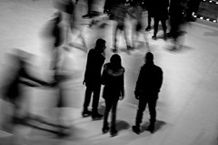 Standing just here, watching ghosts skating on ice. (Capitancapitan) Tags: ice ghosts city park nyc new york magic skating people peace love music photography black white street monocolor