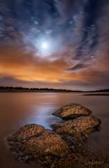 Calmed waters, troubled skies. (darklogan1) Tags: water rocks moon clouds night nightphotography longexposure sonysonyilce7rm3 sonyfe1635mmf28 spain madrid logan darklogan1