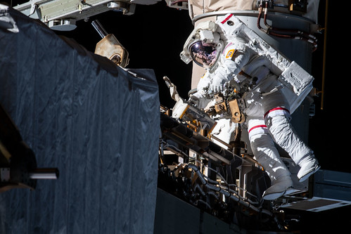 NASA astronaut Andrew Morgan works while tethered on the Port 6 truss