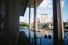 From The Capital Building (goodfella2459) Tags: nikonf4 afnikkor24mmf28dlens kodakektar100 35mm c41 film analog color colour honolulu hawaii city buildings water capitalbuilding manilovefilm