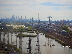 Driving into NYC on the Turnpike - railroad yard and skyline - industrial - ugly (THANKS for 3.6 Million Views) Tags: turnpike nj railroad yards skyline nyc newyorkcity towers water meadowlands industrial decay abandoned substation power electrical warehouse overcast clouds sky ugly newjersey brownearth wasteland polluted despair