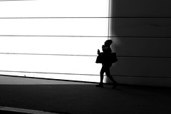 On the border (pascalcolin1) Tags: paris13 femme woman wall mur lumière light ombre shade frontière border photoderue streetview urbanarte noiretblanc blackandwhite photopascalcolin 50mm canon50mm canon