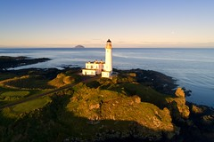 The lighthouse and castle ruins, Turnberry, Ayrshire (iancowe) Tags: turnberrylighthouse sunrise turnberry lighthouse ailsacraig ailsacourse ayrshire maidens nlb northernlighthouseboardnorthern boardfirth clyde firth aerial drone dji trump golf course open scotland scottish morning