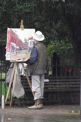 All Weather Artist (catrionatv) Tags: hampshire winchester greatminsterstreet rain pavement tree outerclose winchestercathedral railings bench ghostlyfigure thermosflask coat easel canvas painting thesquare paints brushes donlevine downpour artist