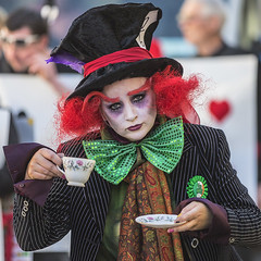 Mad Hatters Tea Party (Frank Fullard) Tags: frankfullard fullard candid street portrait madhatter tea teaparty red green colour dressedup costume lol fun makeup color mayo irish ireland face expression parade tie bowtie cup saucer drinking beverage