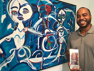 Jumaane N'Nambi, owner of N'Nambi Contemporary in Little Haiti, with the work of Paul Gentry, during the progressive art brunch