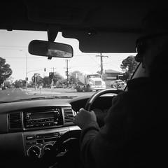 Driving (photo 2) (Matthew Paul Argall) Tags: pouvastart fixedfocus 120 120film mediumformat blackandwhite blackandwhitefilm squareformat squarephoto 6x6 ilforddelta100 100isofilm driving
