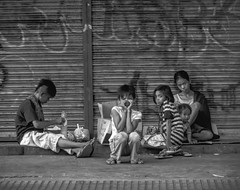 Passing glances (FotoGrazio) Tags: poverty growinginpoverty waynesgrazio streetscene street people fotograzio socialdocumentaryphotography gloweffect inequality philippines hunger photojournalism socialinjustice etheral thephilippines poor waynestevengrazio monochrome waynegrazio why streetphotography filipino softfocus homeless bw blackandwhite monochromatic travel
