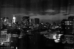 NYC through the curtain (hervedulongcourty) Tags: canoneos5dmarkii canoneos city cityscape canon planar5014ze citylife rivingtonhotel streetbnw nyc photography bw carlzeisslenses citybnw photo night usa manhattan lightandshade citylight manualfocus nuit nb light hotelonrivington carlzeiss ombre blackandwhite zeiss streetlight unitedstates lowereastside shadow zeissplanart1450ze