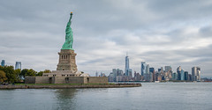 Lady Liberty (John Brighenti) Tags: flickr nyc newyork newyorkcity excelsior travel vacation autumn fall october tourism tourist outside outdoors city urban town buildings architecture skyscrapers sky clouds water wideangle 24mm photography skyline cityscape metro sony alpha a7rii ilce7rm2 sel24f14gm gm gmaster bealpha sonyshooter worldtradecenter empirestatebuilding statueofliberty sculpture copper patina island liberty distance boat river