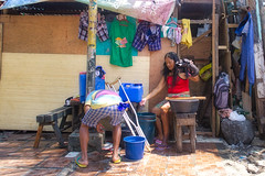 Wash Day (Beegee49) Tags: street people man woman washing clothes happyplanet sony a6400 city philippines asia bacolod