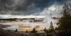 Porcelain Basin (byron bauer) Tags: byronbauer thermal pool fumaroles steam hot water springs color bacteria geyser rain mud clouds trees sky storm sulfur painterly reflection heat caldera basin yellowstone topaz simplify restyle impression bubble boil norris national park cauldron