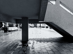 Stepping Under (esallen52) Tags: blackwhite architecture people outdoors daytime staircase lines shapes pavement city urban
