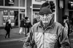 Beanie (Leanne Boulton) Tags: urban street candid portrait portraiture streetphotography candidstreetphotography candidportrait streetportrait eyecontact candideyecontact streetlife old elderly man male face eyes expression mood emotion feeling beanie hat autumn cold weather tone texture detail depthoffield bokeh naturallight outdoor light shade city scene human live living humanity society culture lifestyle people canon canon5dmkiii 70mm ef2470mmf28liiusm black white blackwhite bw mono blackandwhite monochrome glasgow scotland uk