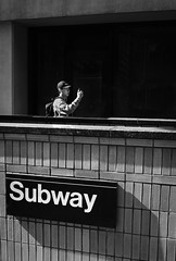 Strolling Man Taking Selfie Near Subway Entrance (Kenneth Laurence Neal) Tags: newyorkcity cities street streetphotography subway cellphone urban people color contrast cityscape nikon nikond7100 walking shadows vivid blackdiamond