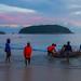 Thai fishermen on the boat are preparing to put the net. Nai Harn Beach, Phuket, Thailand