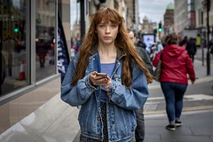 Text and Subtext (Leanne Boulton) Tags: urban street candid portrait portraiture streetphotography candidstreetphotography candidportrait streetportrait eyecontact candideyecontact streetlife woman female girl face eyes expression mood emotion feeling smartphone phone mobile technology network redhead ginger hair denim style fashion fringe bangs tone texture detail depthoffield bokeh naturallight outdoor light shade city scene human life living humanity society culture lifestyle people canon canon5dmkiii 50mm ef50mmf14usm colour glasgow scotland uk